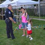 A Villa Park Police Officer stops to talk with a woman at a National Night Out event at the Iowa Community Center, Aug. 2.